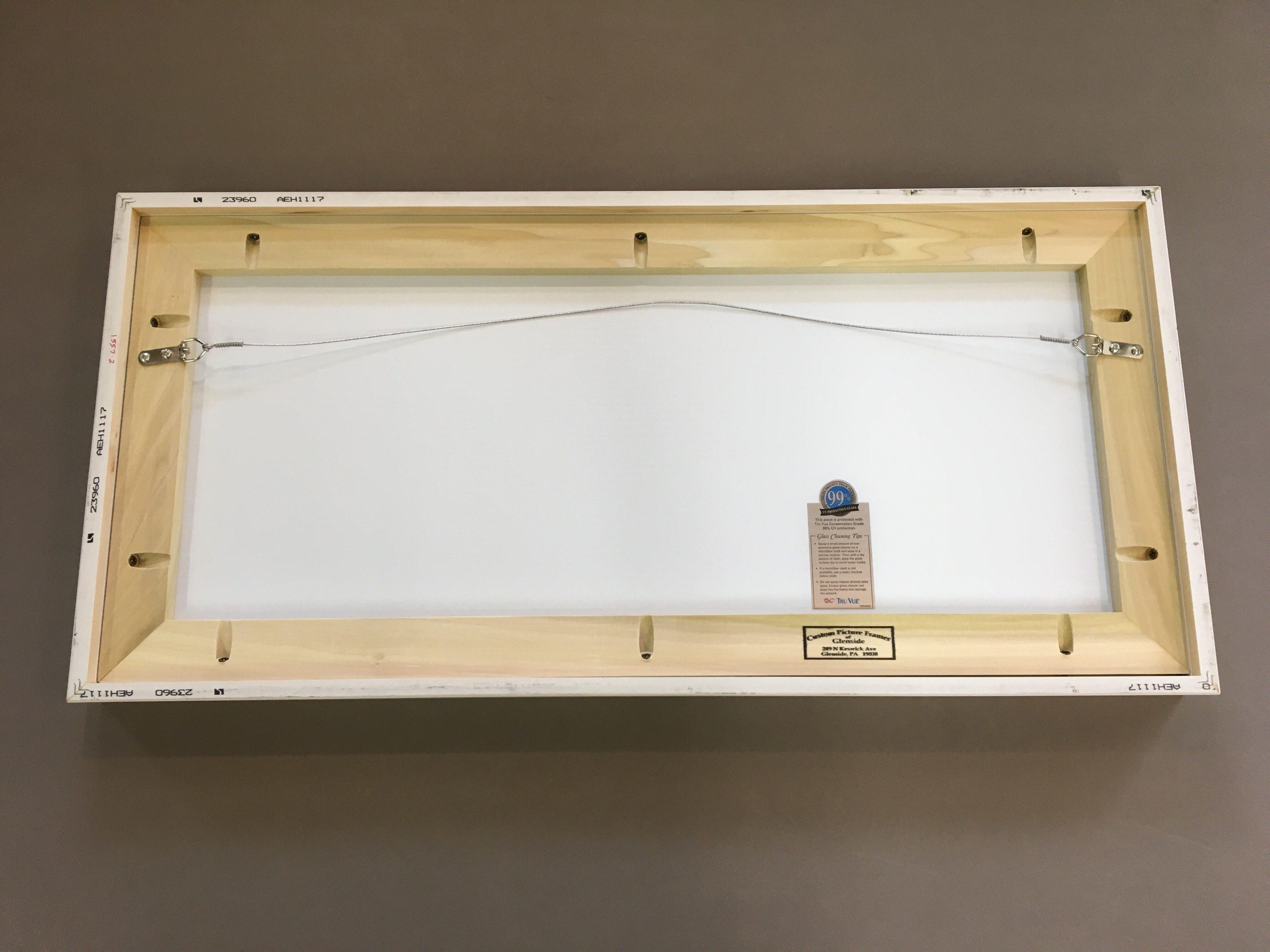 The back of a strainer reinforced custom frame