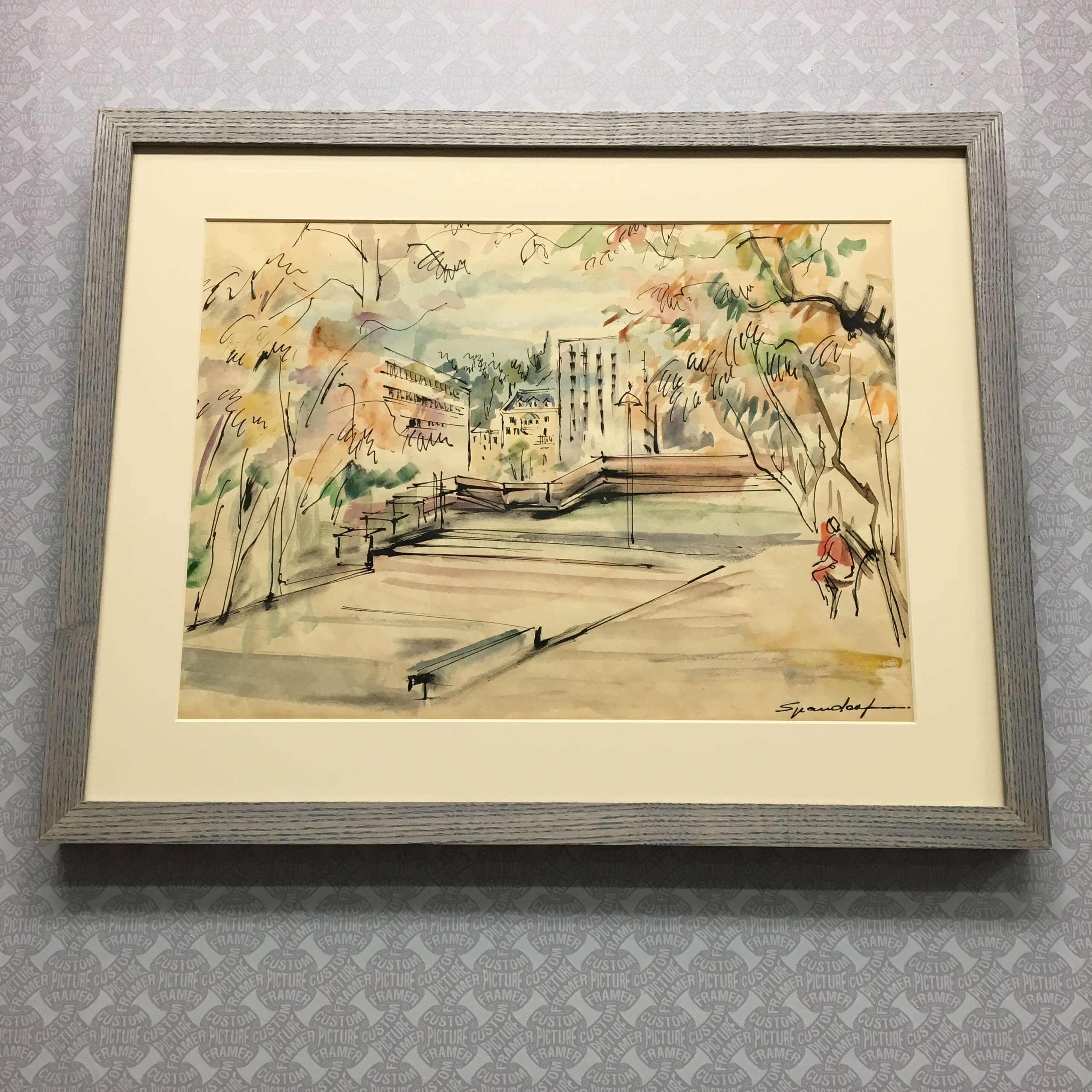 """Original """"City Plaza"""" watercolor by Lily Spandorf (1914-2000) custom framed in a grey wash ash frame sourced and milled in Pennsylvania. See more custom framing options at our Keswick Village showroom located just north of Philadelphia in Glenside PA ( Pennsylvania ) , 19038 . Custom Picture Framer of Glenside carries several thousand frame styles, prints, maps, limited editions, mirrors, and more!"""